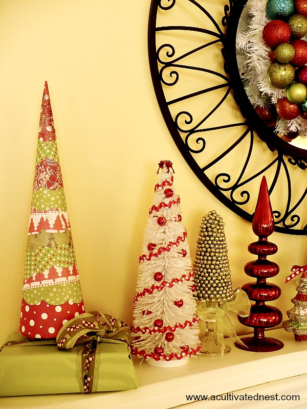 Mod Podge scrapbook paper and Styrofoam cone makes a fun Christmas decoration for this colorful mantel
