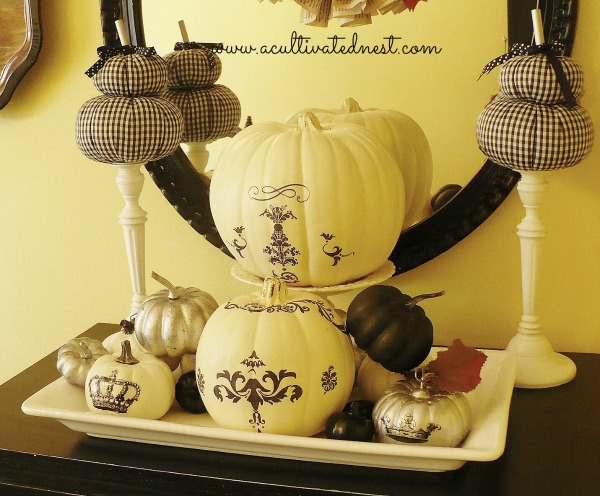 black and white pumpkins decorated with decals