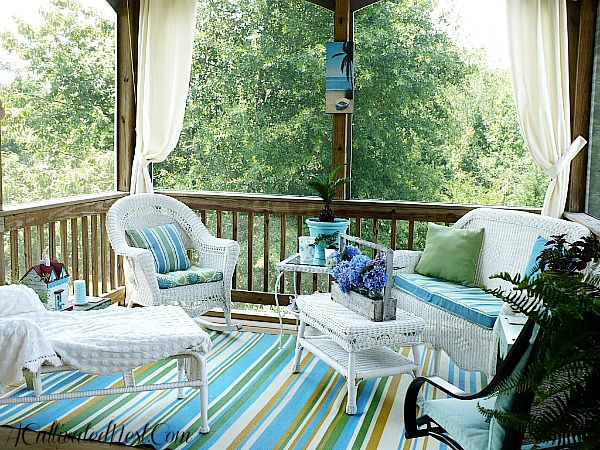 screened in porch decorated in blue and white
