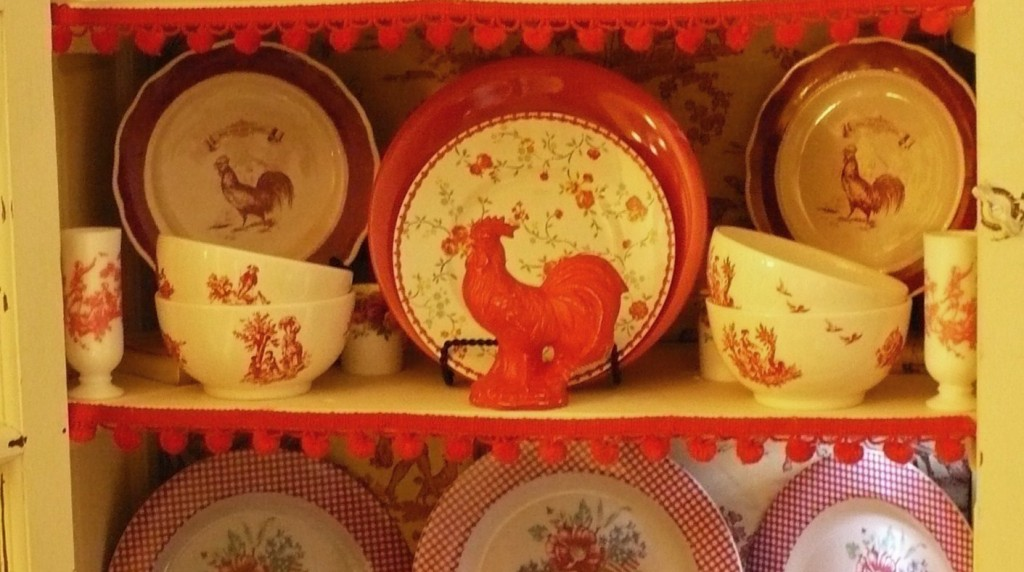 red rooster in a china cabinet