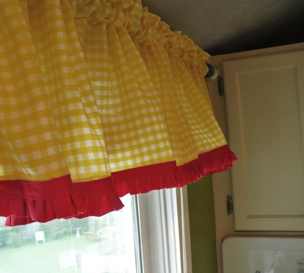 Yellow gingham curtains with red trim