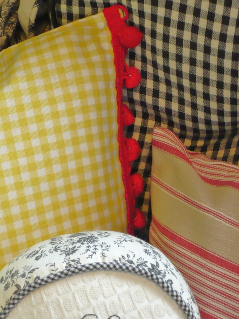 yellow gingham pillow with red trim