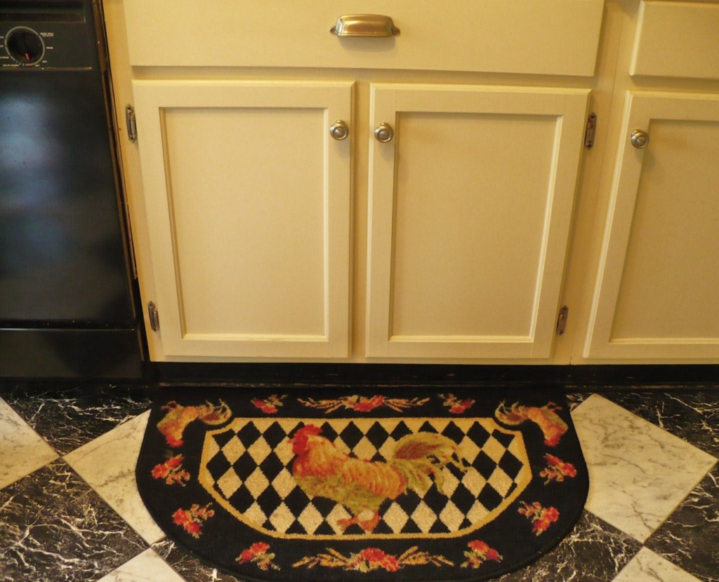under sink cabinets and rooster rug