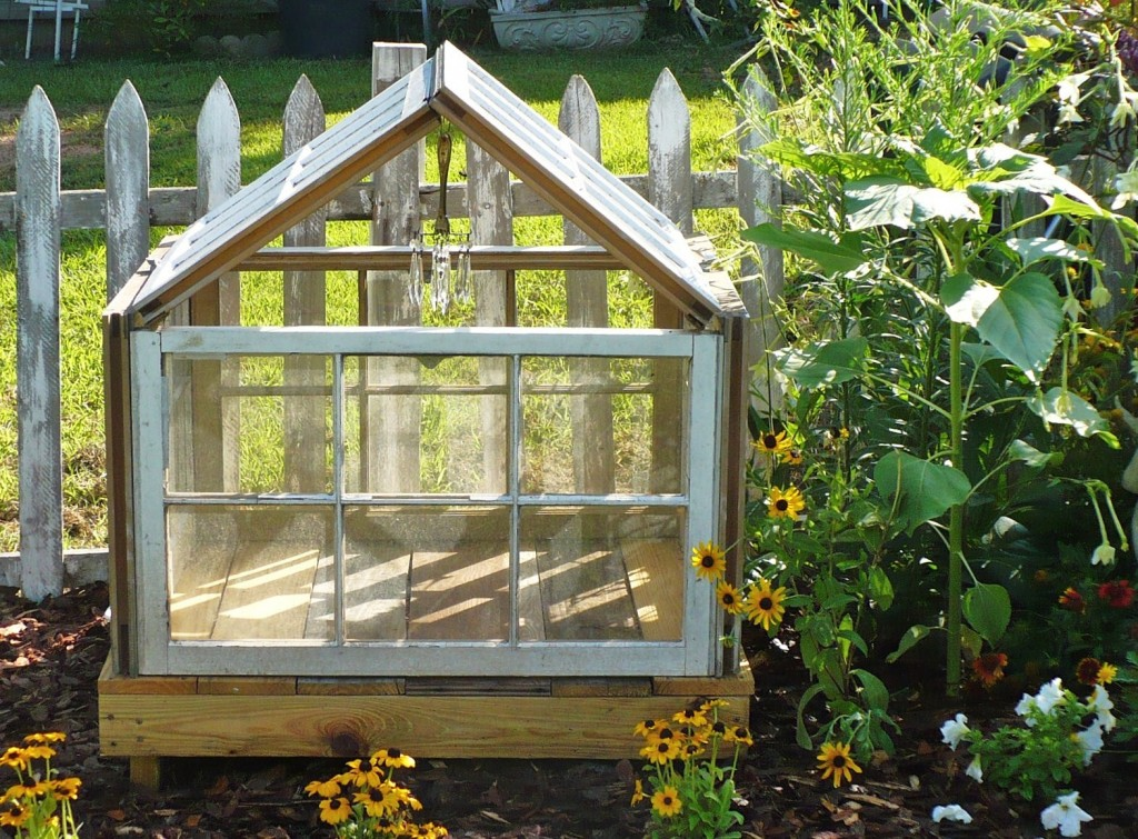 up-cycled or recycled windows made into a conservatory for the garden