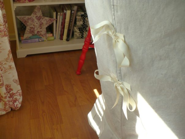 ribbon closure on slip covered chair