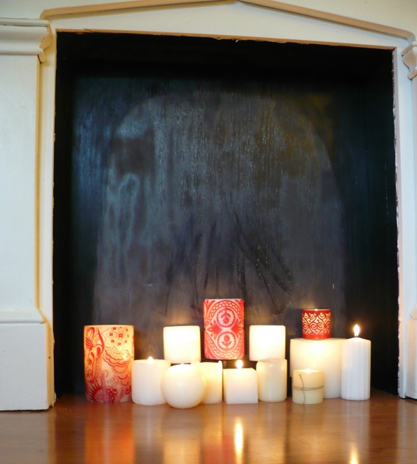 candles in a faux fireplace