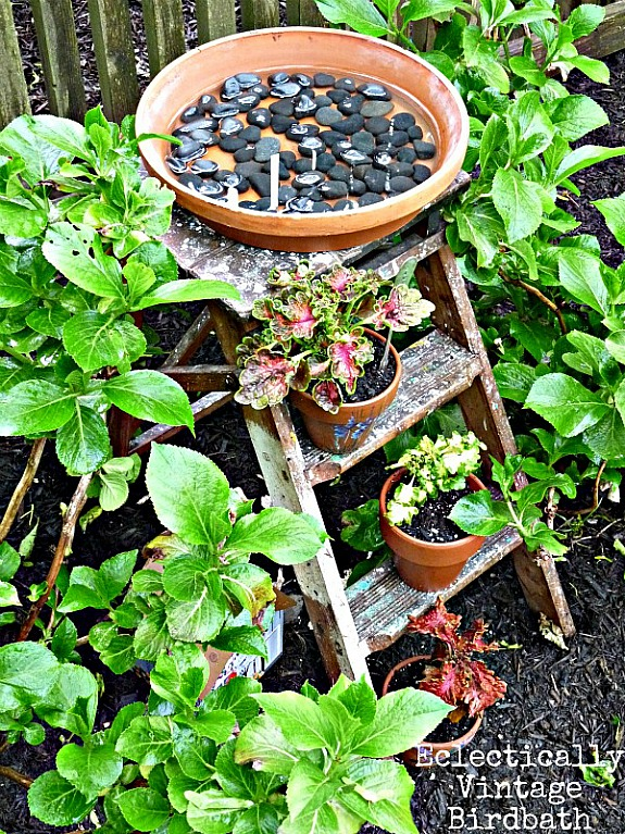 ladder made into a birdbath by Eclectically Vintage | Roundup of ladder repurposing ideas