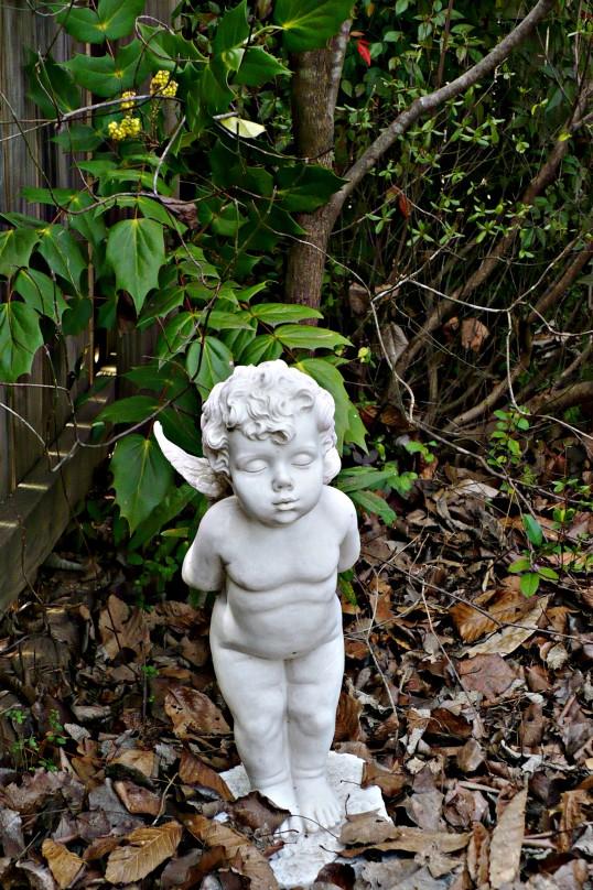 cherub statue in garden