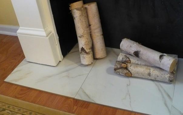 birch logs in a fake fireplace