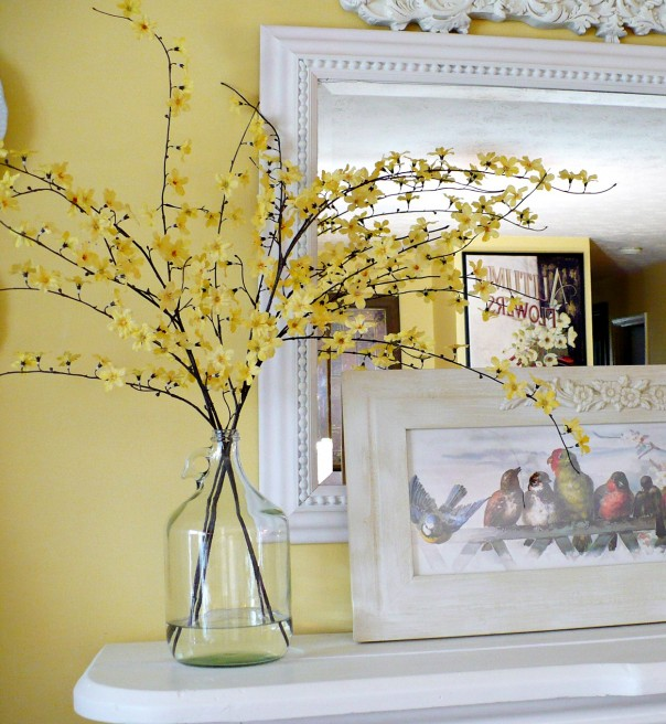 spring flowering branches in upcycled glass bottle