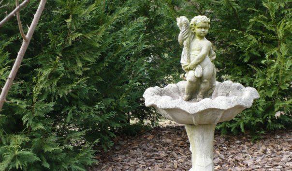 cherub statue in birdbath