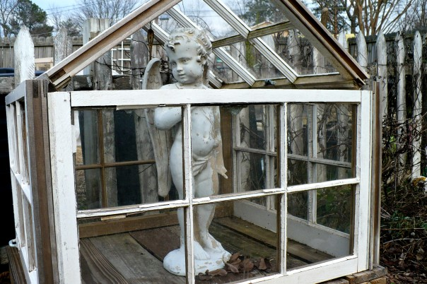 recycled windows into a little greenhouse