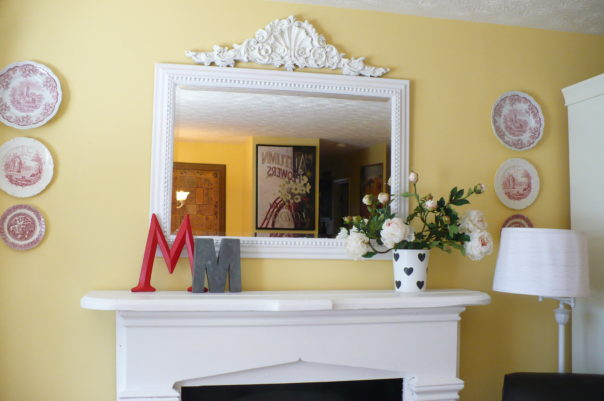 white mirror over fireplace