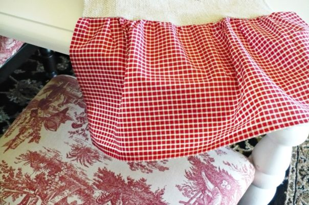red toile chair and burlap and gingham tablerunner
