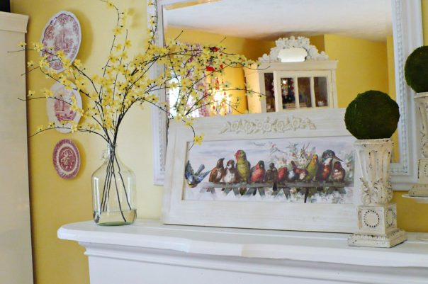 fireplace mantel decorated with spring blooming branches