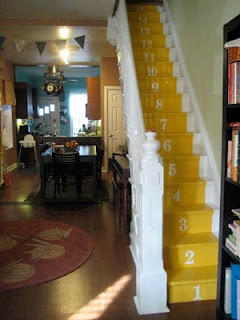 stairs painted with a yellow runner
