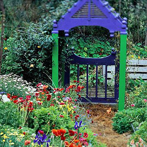 blue and green garden gate and arbor