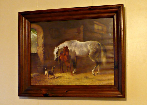 print of horses in a wooded frame
