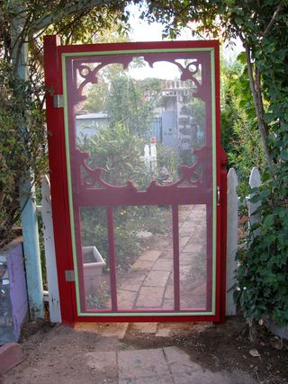 red screen door in the garden