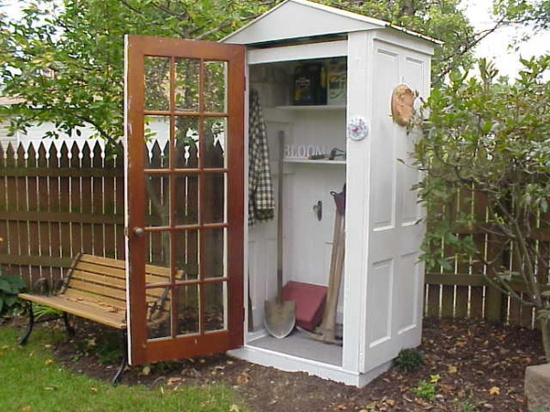 small garden shed made from doors