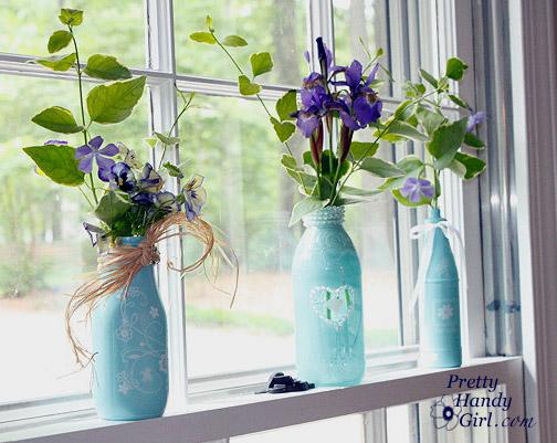 spray painted glass flower bottles