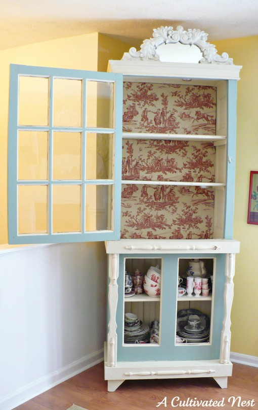 cabinet with back lined in red toile