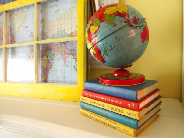 back to school mantel - vintage globe on top of books