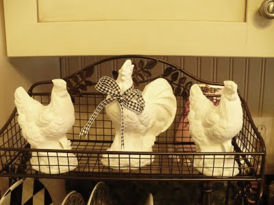 white ceramic roosters