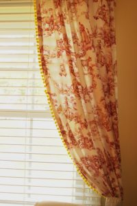 Red Toile Curtains with Yellow Pom Pom Fringe!