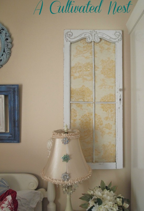 Ways to use old windows | a vintage window backed with toile from A Cultivated Nest