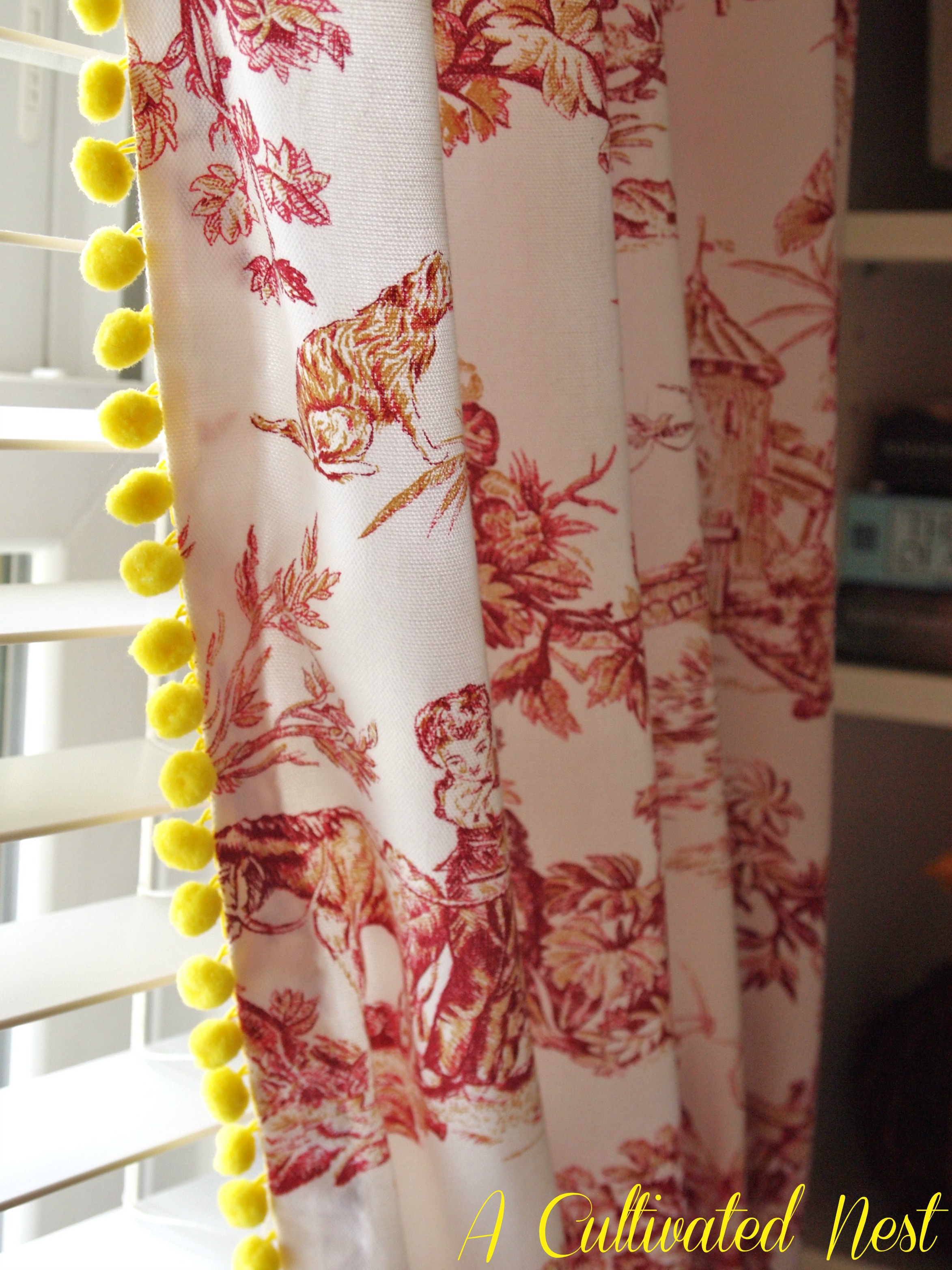 ball fringe curtains. red toile curtains with yellow pom fringe! ball fringe