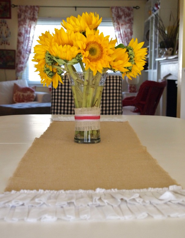 flowers on a burlap runner