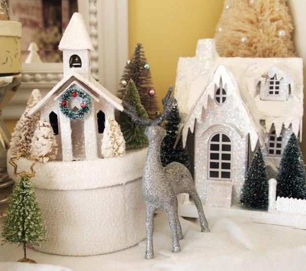 Glitter deer nestled among glitter houses