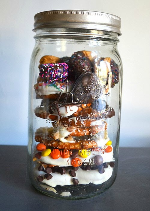 mason jar filled with homemade chocolate covered pretzels
