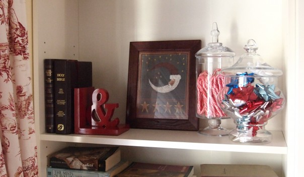Easy Christmas Decorating ideas like filling apothecary jars with ribbon and Christmas Candy