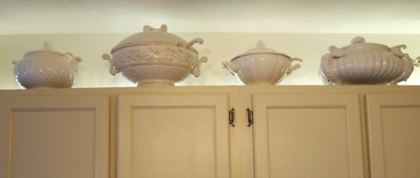 soup tureens above cabinets