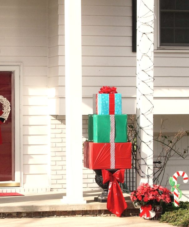 Great holiday curb appeal projects. Make a Outdoor Christmas present topiary.