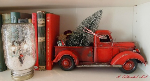 red toy truck with Christmas tree