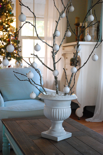 Easy Christmas decorating idea like this Christmas urn with branches