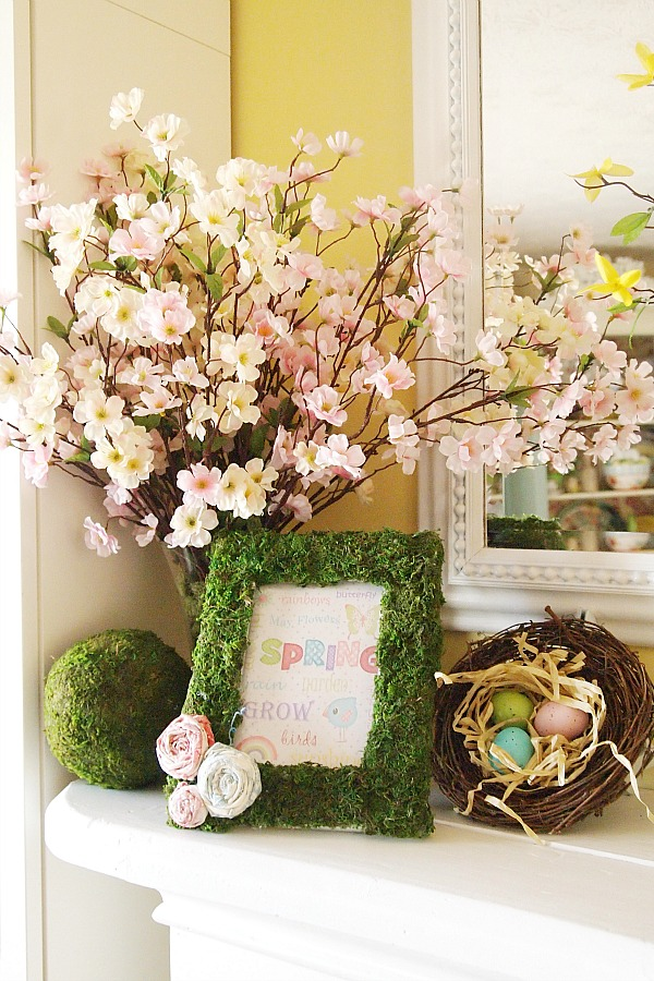 faux dogwood blossoms in a vase
