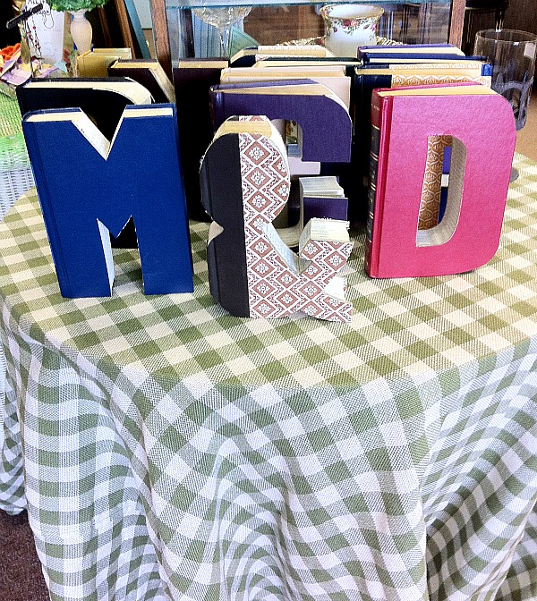books cut into the shape of letters