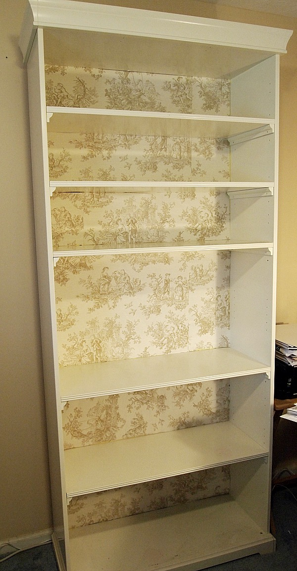bookcase backed with toile paper