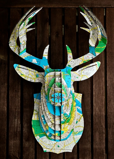 cardboard deer head covered in maps