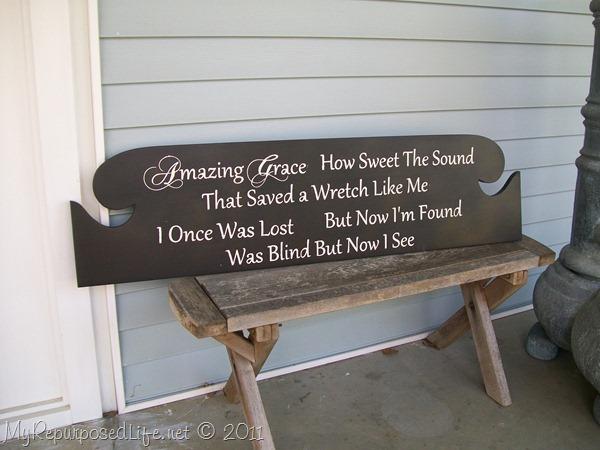 repurposed headboard into a sign