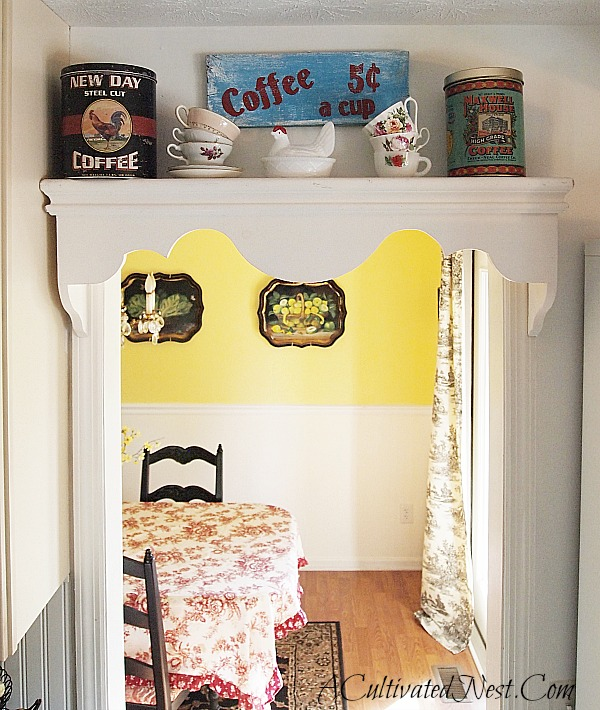kitchen shelf decorated with vintage coffee cans