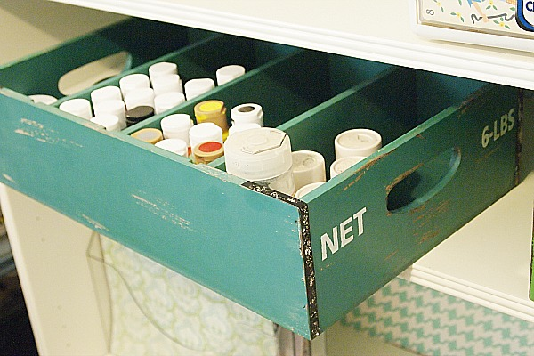 wooden bin that organizes craft paint