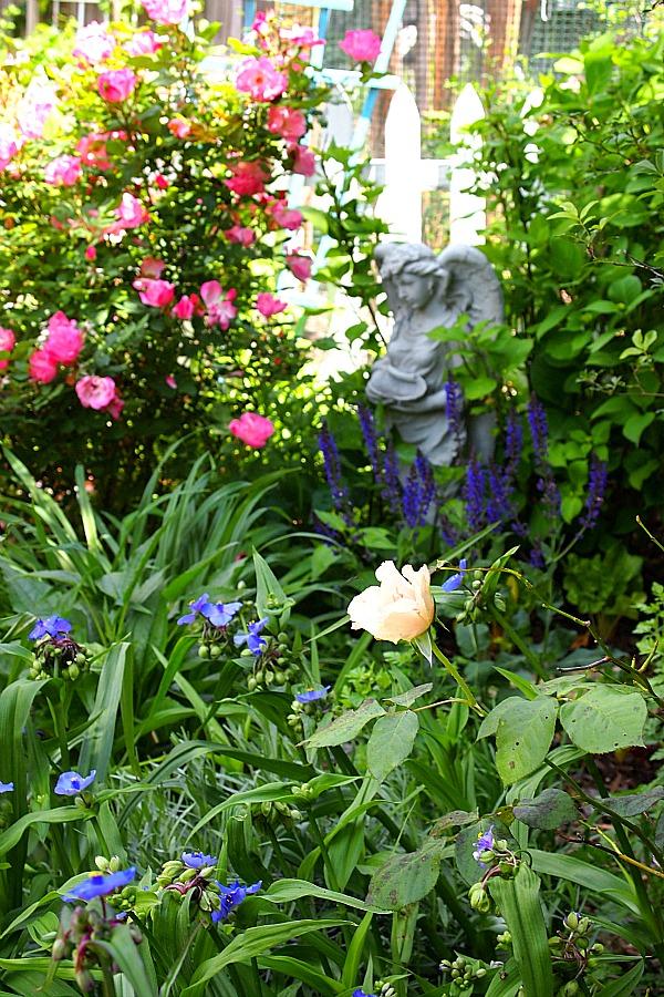 angel statue in a cottage garden