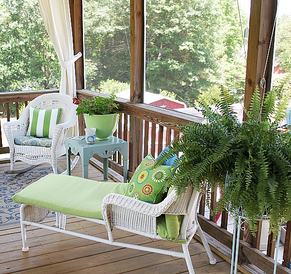 all weather wicker chaise on porch