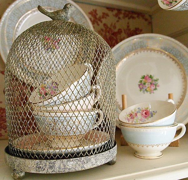 cups in a wire cloche