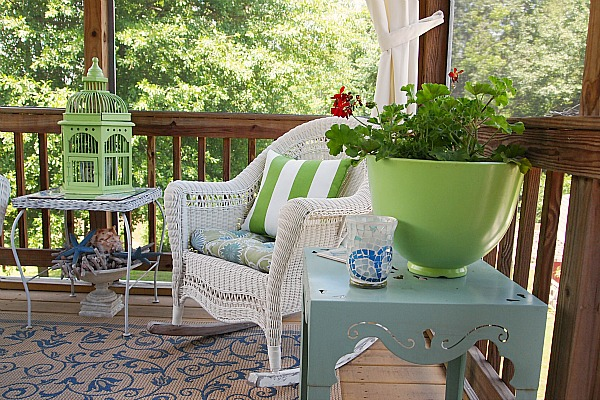 decorating with green accents on a screened in porch